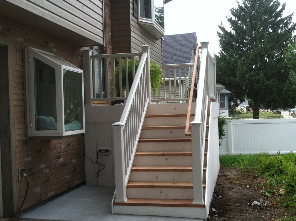 Front porch with stairwell deck builders omaha j g for Front porch construction